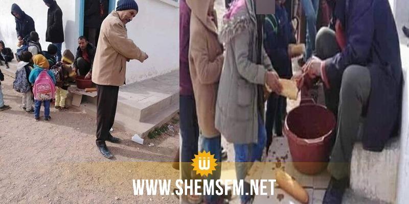 القصرين: فتح تحقيق إثر نشر صورة لشخص يوزع اللمجة على تلاميذ وأمامه إناء بلاستيكي